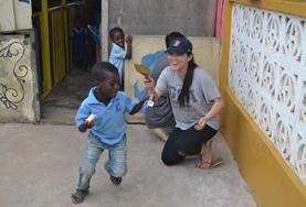 A qualified Social Worker plays a game with local children at her volunteer placement in Ghana.