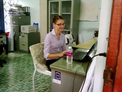 Projects Abroad volunteer working in an office in Cambodia
