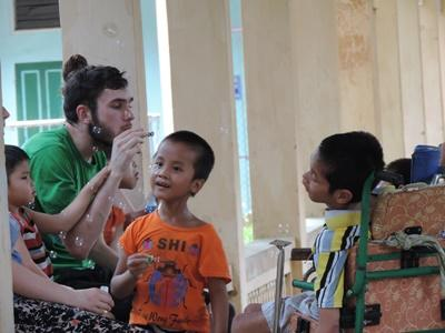 Male volunteer busy in a speech therapy project in Vietnam, Asia