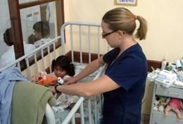 A qualified Occupational Therapist assesses the functioning of a young disabled child at our volunteer placement in Bolivia.