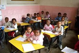 A class of school children listens intently to the lesson given by a volunteer professional English Teacher in Ethiopia.