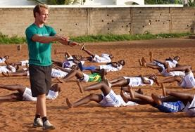 A professional Physical Education Teacher works on children's ball skills during his volunteer placement in Ethiopia.