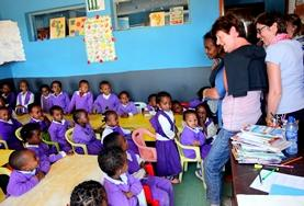 A qualified Science Teacher stands at the blackboard with the school students from her volunteer placement in Ethiopia.