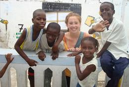 A High School Special Building & French volunteer spends time with the children at the school in Senegal where she is doing renovation work.