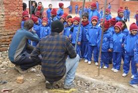 High School Special volunteers begin laying the foundation for an earthquake-proof classroom being built in Nepal.