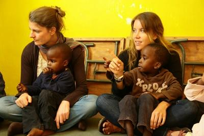 Female volunteers work at an orphanage in Kenya.