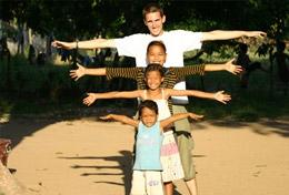 A Volunteer and children pose for a picture at a Care and Community Placement in Cambodia