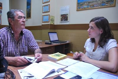 A volunteer on the journalism placement in Romania conducting an interview
