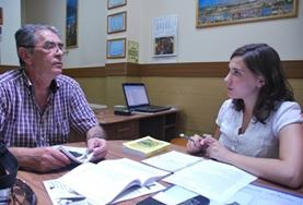 A Journalism volunteer has a discussion with a project supervisor at her placement in Romania