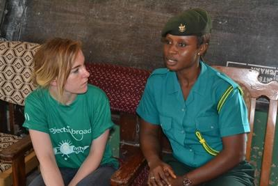 Projects Abroad Human rights volunteer from Ireland, Anna Moran, chats with an immigration officer about child trafficking in Ghana