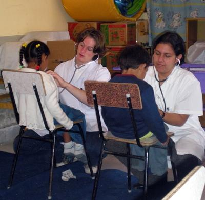 Volunteers give kids a medical check up
