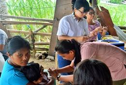 Public Health volunteers interact with patient's at a placement in the Philippines