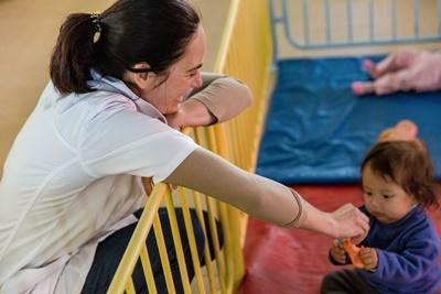 Projects Abroad Social Work intern spends time with a Bolivian child at a care facility in Cochabamba