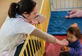 A Social Work Intern interacts with a child in Bolivia