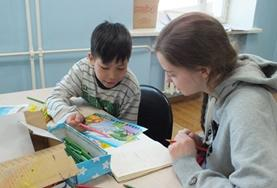 A Social Work Intern interacts with a child in Mongolia