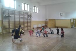 A Football Coach warms up with athletes at a placement in Romania