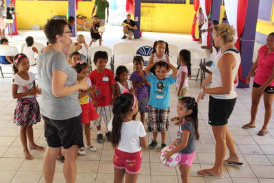 Projects Abroad volunteers playing a game with the children in Belize