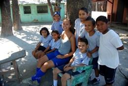A group of school children relaxes after their sports lesson as part of our volunteer School Sports project in Costa Rica.