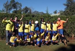 A local football team poses together before a sports lesson at our volunteer School Sports placement in Kenya.