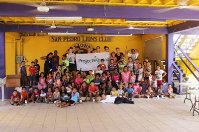 A group photo of the Projects Abroad Teaching volunteers in Belize, staff and the children