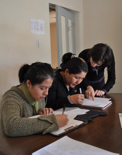 A volunteer teaches some of her adult learners at a university in Bolivia, Latin America