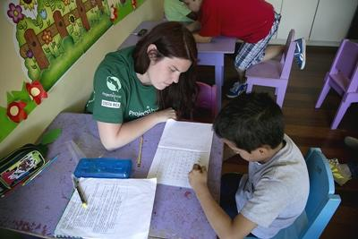 A volunteer teaches one of her students at a school in Costa Rica, Latin America
