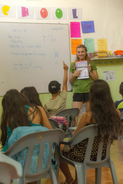 Female Projects Abroad volunteer teaching a class to her students