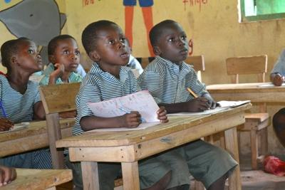 Local children learn in a school in Ghana, Africa
