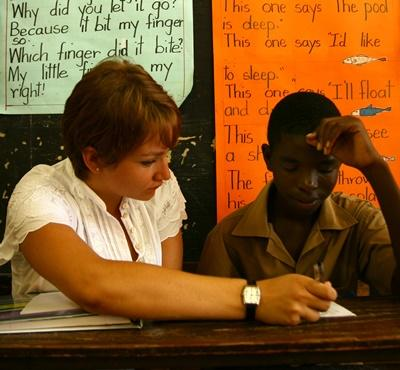 A Teaching volunteer helps one of her school students in Jamaica
