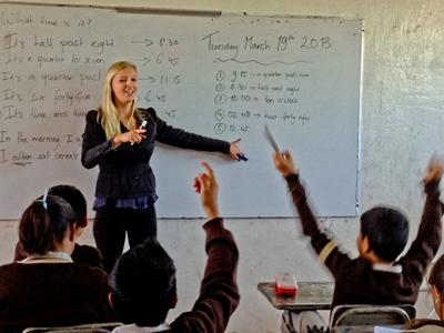 A Teaching volunteer teaches her class in Mexico