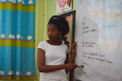 A Projects Abroad volunteer teaching French to Moroccan students in a classroom in Rabat