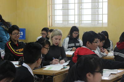 A Projects Abroad volunteer assisting a student on a French Teaching placement in Vietnam