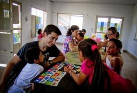 A Teaching volunteer in Argentina plays a fun educational game with school children to help improve their English skills.