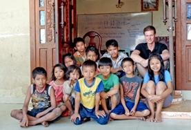 A volunteer is pictured with children at a Teaching Project placement in Cambodia