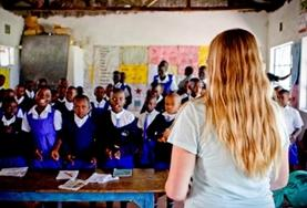 A volunteer teaches an interactive English lesson to a class of school children at our placement in Kenya.