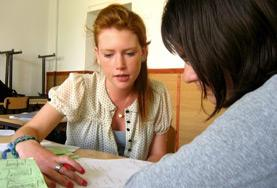 A Teaching volunteer assist a student at a placement in Romania