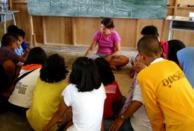 A Teaching volunteer runs a creative lesson with students at a local school in Thailand.