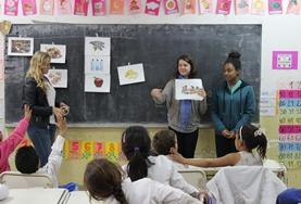 A volunteer teaches German to a class on a Teaching Placement in Argentina