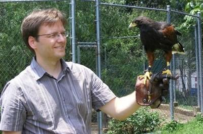 Older volunteer working to rehabilitate a bird of prey on a Projects Abroad Falconry placement