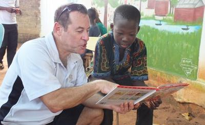 Projects Abroad Australian volunteer takes part in the Reading Club at a care placement helping children in Togo